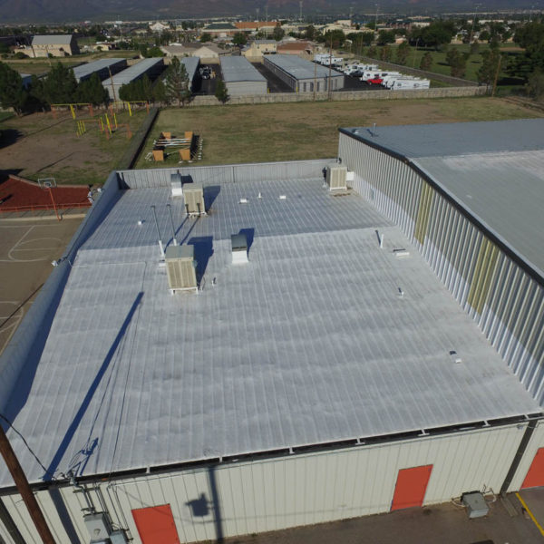 Spray foam over metal roof