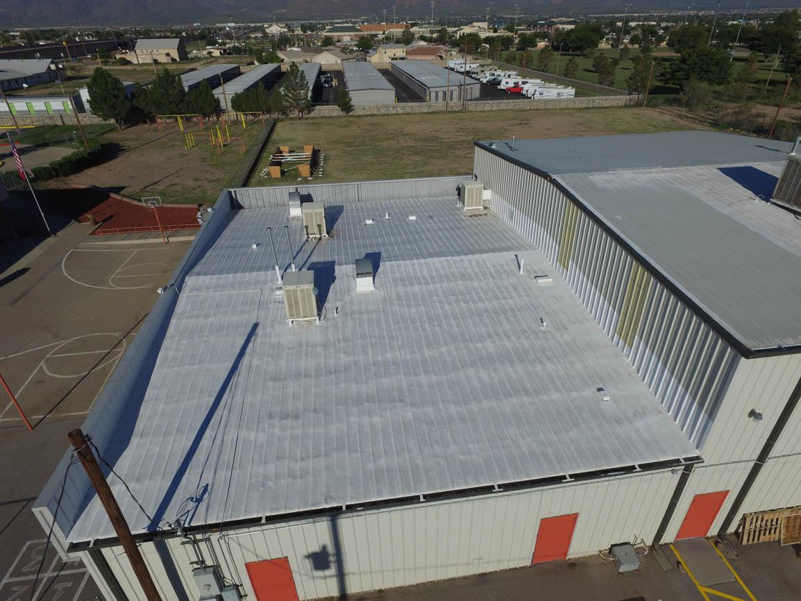 Spray foam over metal roof